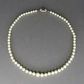 Ladys necklace with akoya pearls closure in white gold filled with tourmaline