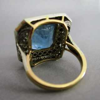 Gold ring with huge aquamarine and diamonds