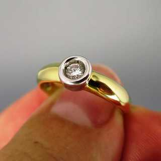 Classic gold ring with solitaire diamond