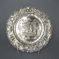 Decorative silver plate with rich relief pattern