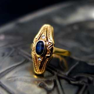 Gold ring with sapphire and diamonds