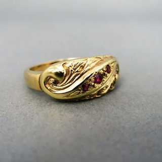 Antique victorian ruby ring in gold with rich relief decoration