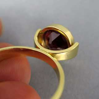 Unique handmade goldsmith gold ring with deep red tourmaline modern design
