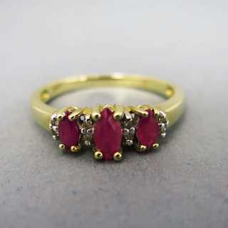 Gold ring with three rubies and diamonds