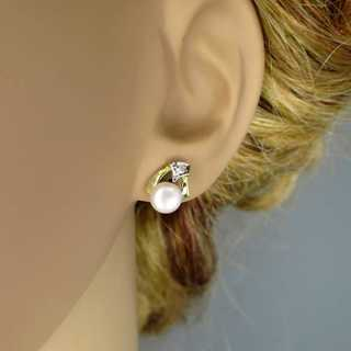 Gold stud earrings with big pearls and diamonds