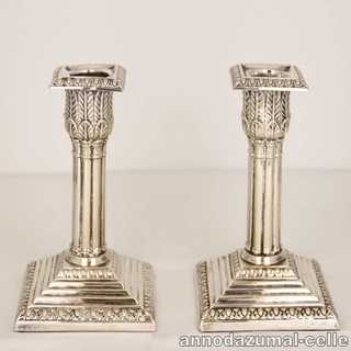 Antique column-shaped candlesticks