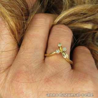 Delicate floral gold ring with diamonds