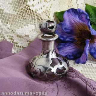 Antique parfume bottle with silver overlay
