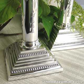 Column-shaped candlesticks in sterling silver