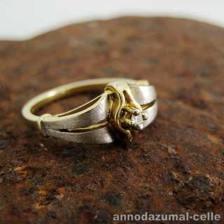 Two tone gold ring with diamond