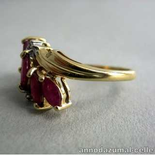 Delicate gold ring with rubies and zirconiums