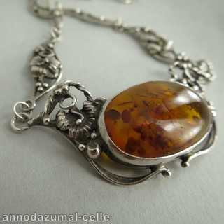 Floral collier with huge amber cabochon