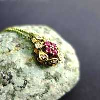 Vintage gold pendant with diamonds and rubies incl....