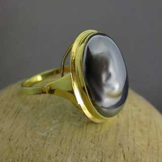 Gold ring with haematite cabochon