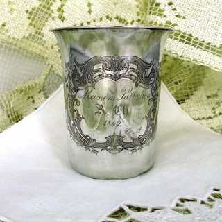 Silver christening mug with engraved decor