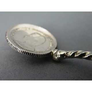 Antique silver spoon with bullet coinage