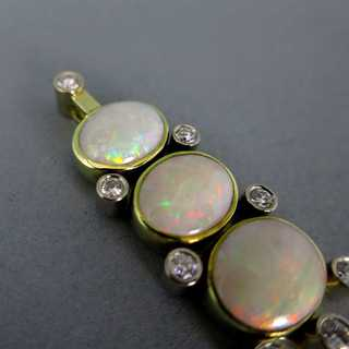 Gold ladys pendant with genuine oval opal cabochons and diamonds
