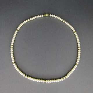 Nice pearl necklace with gold beads