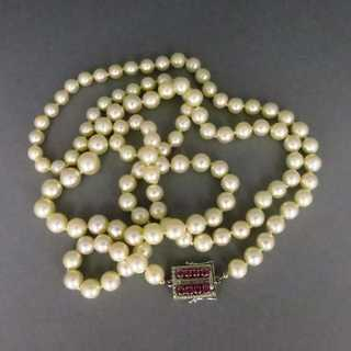 Akoya pearl necklace, rubies and white gold