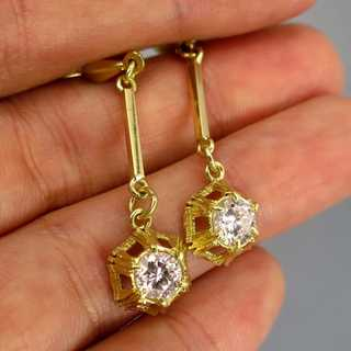Beautiful long womens earrings in gold set with large diamonds