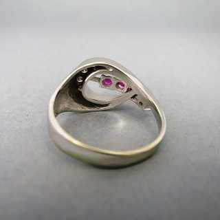 Curved white gold ring rubies and diamonds