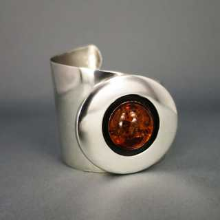 Modernist unique bangle in silver with honey amber cabochon Germany