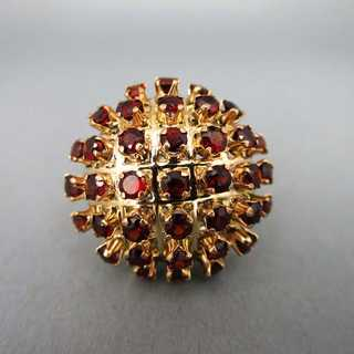 Wonderful ladys cluster ring open worked in gold with dark red tourmaline