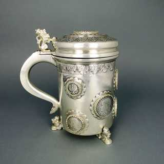Massive and heavy silver mug with coin medallions