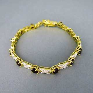 Vintage tenis link bracelet in gold and silver with heart shaped red garnets