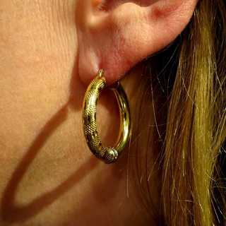 Wonderful decorated women creole earrings in 18 k yellow gold
