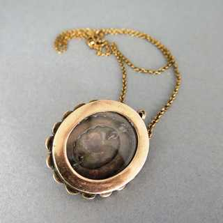 Huge oval medaillon pendant with garnets in silver and gold