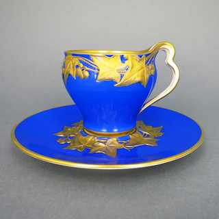 Antique Art Nouveau KPM Berlin porcelain cup with saucer in blue and gold
