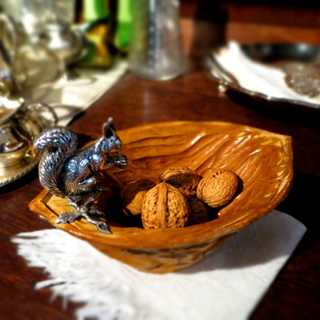 Charming walnut wood bowl with massive silver cast squirrel figure