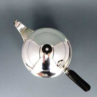 Late Art Deco tea pot in silver and ebony Goldsmiths & Silversmiths Co. London