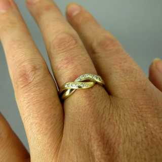 Two tone 14 k gold woven design ladys ring with many small diamonds