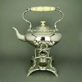 Elegant antique victorian tilting tea pot silver plated with ivory handles 1869