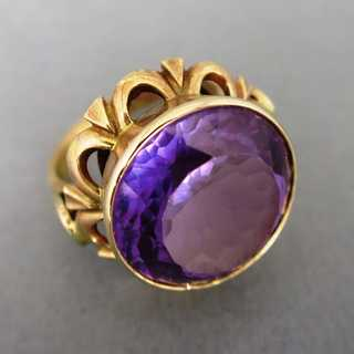 Gold ring with huge amethyst stone