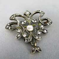 Precious18 k gold and silver brooch with rose cut...