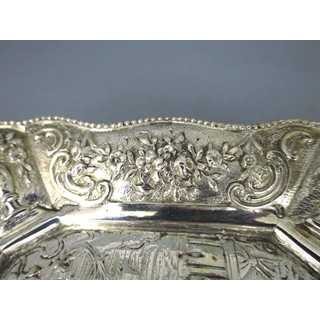Decorative silver plate with relief decor