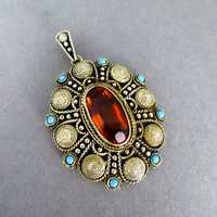 Beautiful silver and gold filigree pendant with...
