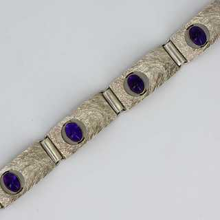 Abstraktes Silberarmband in 835/- Silber besetzt mit Amethyst Cabochons