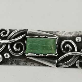 Art Nouveau brooch with a green agate in silver 900 / -