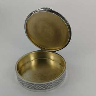 Charming round box in silver with rich decor