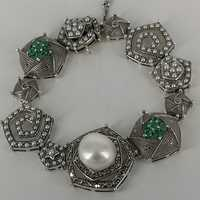 Exceptional bracelet in silver with pearls and emeralds