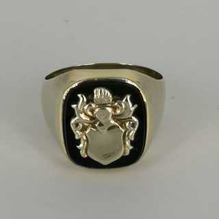 Mens signet ring with gold crest on onyx plate