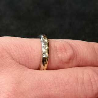 Unique designer ladies band ring in white and yellow gold with three diamonds