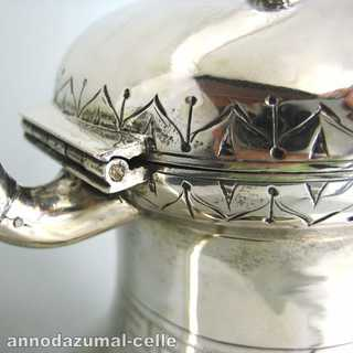 Silver coffeepot with engraved decor