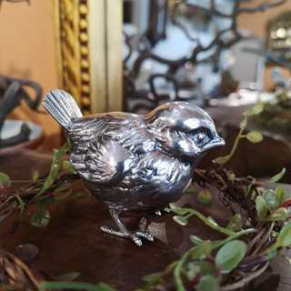 Small, detailed shaped garden bird in solid silver