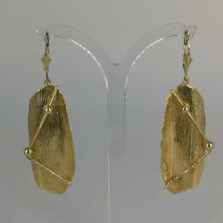 Modern earrings in gold in an abstract form