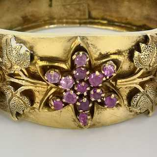 Antique ladies bangle in gold-plated silver with rich decor and rubies